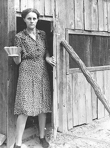 Goochland Co., VA, Mrs. Williamson leaving poultry house which she constructed